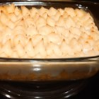 Scottish Shepherd's Pie - Cubed ham is arranged in the bottom of a casserole dish, topped with creamed corn and briefly heated in the oven. Mashed potatoes are spooned on top, and then the pie is returned to the oven. Just before serving, it 's dotted with butter and slipped under the broiler to brown.