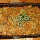 Amanda's Potatoes - A gourmet twist on Potatoes Au Gratin with caramelized onions and fresh herbs. Great for brunches and potlucks.