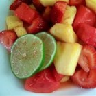'Something Different' Fruit Salad - The lime, honey, and cayenne pepper dressing really brings out the flavor of the fruits in this easy-to-put-together fruit salad. This is a tasty, fresh, and colorful side dish perfect for any summer meal.