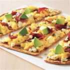 Smoked Turkey Sausage Tex-Mex Style Pizza - Quick and easy, this flatbread pizza with smoked turkey sausage, salsa, Cheddar cheese, and jalapeno slices is ready to serve in just minutes.