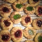 Thumbprint Cookies III - Like a butter cookie rolled in nuts with jam in the center. I make these every Christmas to give to relatives and friends. They all love this cookie!  For even more flavorful cookies, try using almond extract instead of the vanilla.