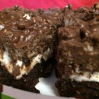 Rocky Road Peanut Butter Brownies - Chocolate brownies are topped with a layer of marshmallows and then smothered in a chocolate-peanut butter topping creating crowd-pleasing rocky road brownies.