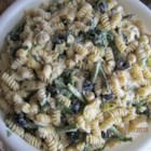 Artichoke Asparagus Pasta Salad - A colorful pasta salad combines tri-color pasta in your favorite shape, asparagus, broccoli, black olives, and artichoke hearts in a creamy ranch-style dressing with lots of Parmesan cheese. The salad rests for 12 hours to chill, so it's great for a make-ahead meal. This recipe makes a big batch.