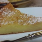 Impossible Buttermilk Pie - Buttermilk, sugar, eggs, baking mix, butter and vanilla are beaten together until smooth, poured into a 9-inch pie pan, and baked. It makes a lovely nest for fresh fruit and a dollop of freshly whipped cream.