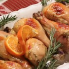 Roasted Orange Rosemary Honey Glazed Chicken - Chicken legs, roasted with an orange rosemary honey glaze, are fall-off-the-bone juicy and great for dinner parties.