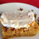Frosted Pumpkin Bars - Canned pumpkin, cinnamon, and pumpkin pie spice help make a delicious bar cookie, completely suitable for the cream cheese frosting.