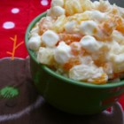 Sarah's Ambrosia Fruit Salad - Ambrosia salad loaded with marshmallows, coconut, pineapple, and mandarin oranges is a refreshing salad to serve at summer picnics.