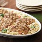 Alfredo Chicken and Broccoli - This quick weeknight dinner features grilled chicken breast fillets served over fettuccine in a creamy pesto Alfredo sauce with broccoli and roasted red peppers.