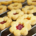 "Stained Glass Window Cookies - These are cookies which have open spaces which are filled with crushed hard candy (yellow and red work best).  When baked, the candy melts and gives the appearance of ""stained glass""."