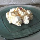 Ambrosia Fruit Salad - Shredded coconut and chunks of pineapple, mandarin oranges, marshmallows, pecans and fruit cocktail are folded into whipped topping and chilled.  Top with maraschino cherries when serving.