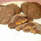 Caramel Chocolate Cookies - Chocolate cookies wrapped around a chocolate covered caramel and dipped in pecans.