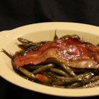 Green Beans - Green beans and bacon are baked in a mixture of brown sugar, butter, and garlic for a tasty side dish even kids will love.