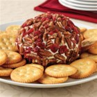 Classic ROKA Cheese Ball - Take a trip down memory lane! This Classic ROKA Cheese Ball, studded with dried cranberries and chopped pecans, tastes as good as you remember.