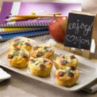 Amazing Muffin Cups - Eggs, sausage, red bell pepper, and cheese are baked in hash brown potato 'cups' for a delicious breakfast that will feed a crowd.