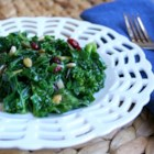 Kale Cranberry Pepita Salad - This kale, cranberry, and pepita salad is a modified version of a national grocery chain's kale salad. It's a delicious way to eat your greens!