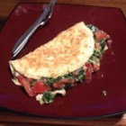 Spinach, Tomato, and Feta Egg White Omelette - Egg white omelette stuffed with spinach, tomato, and feta cheese is an easy and filling way to start the day.
