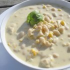 Quick Chicken and Corn Chowder - Chicken and corn chowder is thickened with cornstarch and Cheddar cheese for a warm and comforting soup.