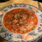 Tomato Orzo Soup - Rice-shaped orzo pasta, peas, diced carrots and celery are cooked in chicken broth in this soup which is finished with fresh minced parsley.