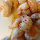 Honey Orange Firecracker Shrimp - Big shrimp are dredged in seasoned cornstarch and pan fried until crisp and golden brown. Serve them with a drizzle of sweet honey sauce.
