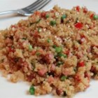 Pork Fried Quinoa - Quinoa makes the perfect substitution for rice in this fried rice-style dish. Cooked ham, bell peppers, and onions add flavor to this hearty and light side dish.
