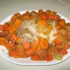 Sweet and Simple Pork Roast - Pork roast is slow-cooked with sweet potatoes, carrots, and onions in an applesauce and white grape juice sauce.