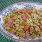 Lima Beans and Ham - This veggie-filled casserole--made with fresh lima beans, corn, potatoes, tomato, celery, and ham--makes a quick and easy stovetop meal.