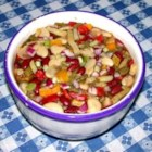 Colorful Four Bean Salad - This is a very tasty and easy bean salad made with four kinds of beans, red onion, and celery in a vinegar dressing. My friend next door gave it to me years ago.