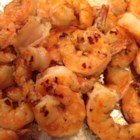 Broiled Lemon and Garlic Tiger Prawns - Tiger prawns are butterflied, brushed with butter and Parmesan cheese, then broiled. This is a family favorite for home movie night; it's quick and easy and kids like the 'finger food' style.