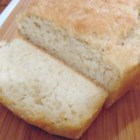 Tastefully Simple Beer Bread - Make a quick and easy loaf of beer bread with just four ingredients: self-rising flour, sugar, butter, and, of course, beer!