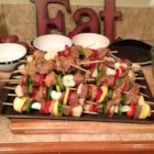 Mom's Beef Shish Kabobs - Beef, bell pepper, mushrooms, and onion are skewered and basted with a soy and lemon marinade to make these tasty summer treats perfect for the grill.