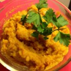 Mashed Butternut Squash - Baked butternut squash is mashed with butter, sour cream, and a hint of brown sugar for a colorful side dish on Thanksgiving.
