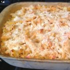 Macaroni with Ham and Cheese Deluxe - This is a dressed up macaroni and cheese comfort food. It combines leftover ham with three varieties of cheese, onion, green pepper, and tomatoes. The whole family will love it.