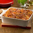 Baked Smoked Sausage Spaghetti Casserole - Cooked spaghetti is baked with cheese in a saucy tomato blend of sausage slices, garlic, bell pepper and mushrooms.