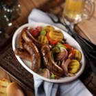 Grilled Italian Sausage with Sweet and Sour Peppers - If you think you know sausage and peppers, think again!  Take the big flavor of Johnsonville Italian Sausages and add bell peppers, almonds, raisins and onions to take the flavor to the next level. Add polenta and Italian dressing for the best sausage and peppers dish you have ever had!