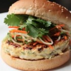 Chef John's Chicken Satay Burger  - Chicken burgers seasoned with southeast Asian flavorings are served on buns with a zesty peanut sauce and Asian-style slaw.