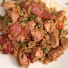 Risotto with Chicken, Sausage and Peppers - Orzo gets cooked risotto-style, using a flavorful stock made with braised chicken and sausage.