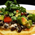 California Tacos - Crispy tortillas layered with black beans, rice, fresh tomatoes, and avocado are similar to tacos in California and are easy to prepare.