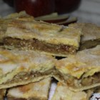 Delicious Apple Pie Bars - Apple pie filling is sandwiched between two layers of pie crust. It's like a portable apple pie you can cut up and share!
