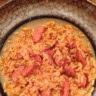 Spruced-up Zatarain's(R) Jambalaya - Start with a boxed jambalaya mix, add andouille sausage, onion, and a can of diced tomatoes with green chile peppers, and finish deliciously.