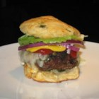 Spicy Serrano Burgers - Mix ground beef with dark beer, butter, serrano peppers, and top with spicy Monterey Jack cheese for these mouth-watering burgers.