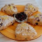 Huckleberry-Lemon Scones - Lovely lemon-glazed huckleberry scone with lots of fresh summer flavor! Perfect tea-time snack.