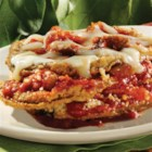 No-Frying Eggplant Parmesan - Breaded eggplant slices are baked then layered with lots of cheese and sauce for a delicious, family-favorite dinner.