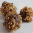 Christmas Casserole Cookies II - In this recipe eggs, sugar, dates, coconut and nuts (use any kind) are baked as a casserole, then formed into balls and rolled in sugar.