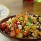 Chopped Cashew Salad - This crunchy cashew salad is loaded with colorful bell peppers, avocado, grapes, and feta cheese for a salad the whole family will love.