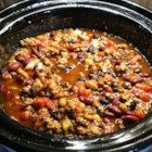 Slow Cooker 3-Bean Chili - Pinto, kidney, and black beans are your trio in this three-bean ground turkey chili made in a slow cooker.