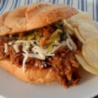 Beer and Bourbon Pulled Pork Sandwiches - Sliced pork gets extra flavorful with an easy spice rub and is slow cooked with a smoky beer and bourbon barbeque sauce.