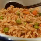 Elena's Yellow Rice - This Spanish-influenced rice side dish uses apple cider vinegar to give it a fluffy texture and a slightly tangy flavor to go with peas and carrots buried throughout.