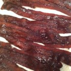 Caramelized Bacon - Bake your bacon slices with a little brown sugar and cinnamon for a sweet change of pace!