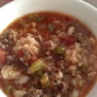 Stuffed Pepper Soup IV - Browned ground round and cooked rice are combined with chopped onions and green peppers with tomato sauce and beef broth in this soup seasoned with thyme and sage.