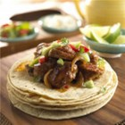 Pork Carnitas with Cilantro Tomatillo Sauce - Slow cooking blends the flavors.